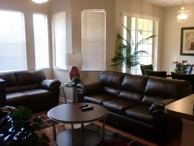 Living Room with 2 plush leather sofas . Dining Room beyond.