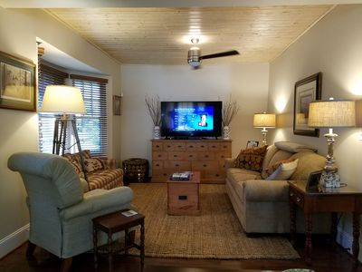 """60"""" Smart TV, 60"""" ceiling fan, and a new sleeper sofa are all part of this room"""