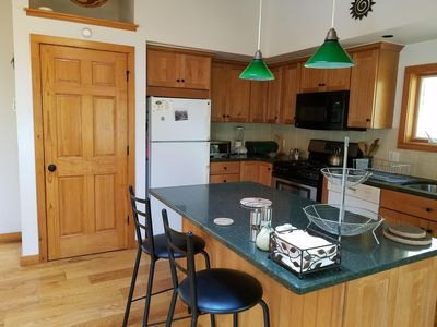 Kitchen workspace and counter. Dishwasher, microwave, plenty of cookware