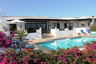 Villa spacious patios and heated pool area