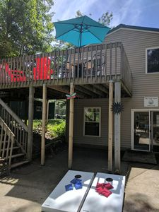 Upper level with deck and lower level. They are separate units rented as one.