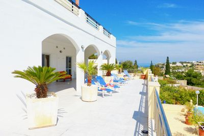 Sunny and shaded terraces surrounding the villa over looking the pool and garden