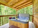 Hot tub on spacious deck with peaceful wooded setting
