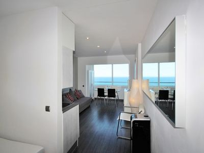 Photo for Beautiful F1 renovated on the beach, superb panoramic view
