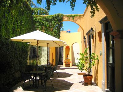 Beautiful main courtyard with 9' fountain and private entrances to the right