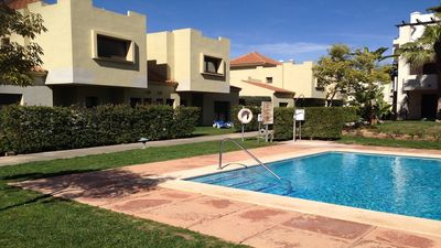 Photo for Luxury Poolside Villa with private garden on 5 Star Roda Golf & Beach Resort