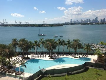 South Beach apartment balcony overlooking the magnificent South Bay Miami