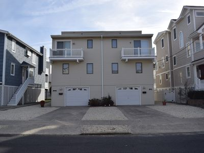 Photo for Beach block/ocean view. Located steps to one of Sea Isle's most popular beaches; with play area, rest rooms and Lou the Hot Dog guy!