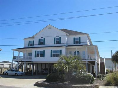 Photo for Modern 4BR, Flatscreens/WiFi, across from beach.