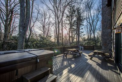 Back deck with tables and hot tub
