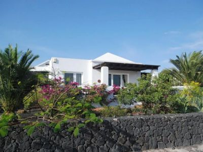 Photo for Elegant Villa with Ocean View, Spacious Patios, and Garden with Palm Trees