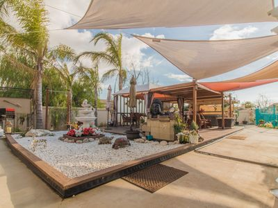 Photo for Paradise Mansion! Vacation with Backyard Canal Access