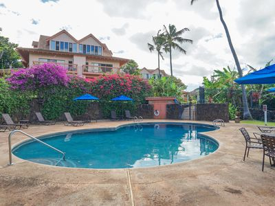 Photo for NEW LISTING! Beautiful 2-story condo w/lanai, shared pool & more - walk to beach