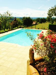 Photo for A beautiful little cottage with a  pool - Stunning views not far from Sarlat ...