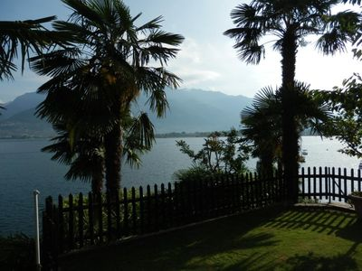 Photo for Luxurious apartment with private beach on Lake Maggiore