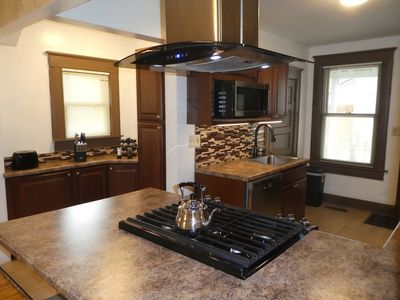 5 burner gas range. Convection oven. Island Hood.