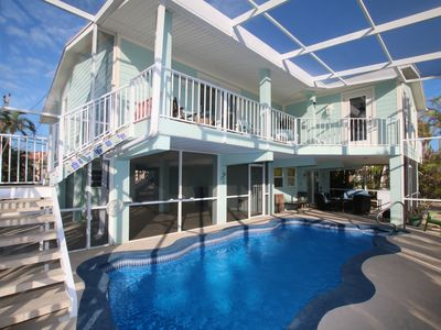 Photo for Rest-A-Shore 🧜 Waterfront Home, Screened-in Private Pool, Near Sombrero Beach!
