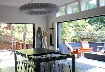 Dining table hides a pool table. See next pic for front deck furnishings.
