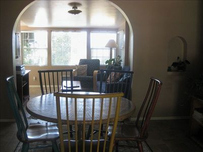 Dining area showing den behind...