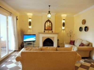 Photo for luxury frontline beach ground floor apartment with seaviews, internet, 4 pools