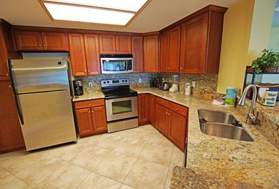 new kitchen cabinets,granite ,countertops,pull down faucet,