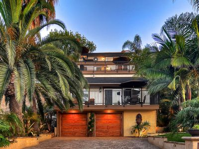 Photo for NEW LISTING! Tropical home w/loft, spacious deck, outdoor dining, walk to beach