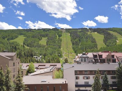 Photo for Walk to slopes, deck w/ mountain views, hot tubs, walk to dining & shopping