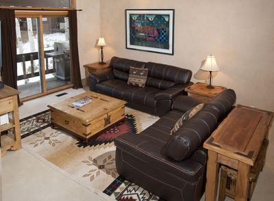 Spacious 2 Story LR, brand new leather couches, flat screen TV, FP, and access t