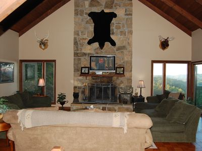 Main level family room. Large seating area for quality time together, great view