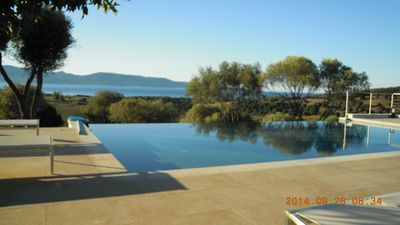 Photo for New villa with a private heated pool and a panoramic ocean and mountain view