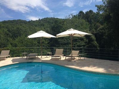 Photo for Secluded villa, heated pool & tennis court, stunning gardens, close to village