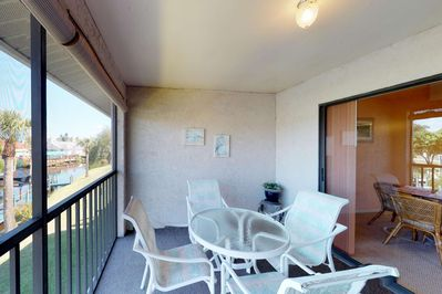 Enjoy your morning coffee, or dinner with a view, on the fully screened balcony with seating for four.