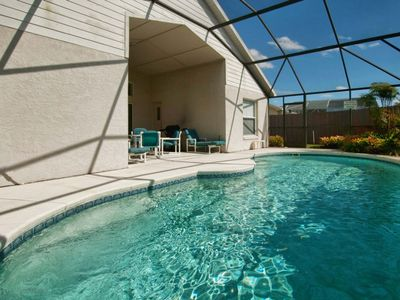 Photo for FAMILY FRIENDLY POOL HOME, CLOSE TO DISNEY, LARGE POOL , BBQ GRILL!!!