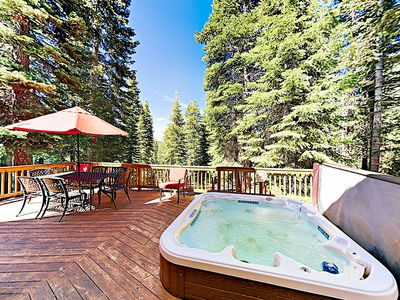 Back Deck - The expansive back deck features a built-in outdoor hot tub and table seating for six.