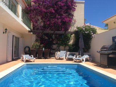 Pool terrace, barbecue, sun lounging beds and dining table and chairs