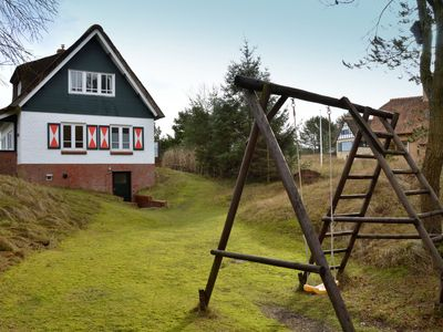 Photo for Beautiful dune villa with thatched roof on Ameland. 800 meters from the beach