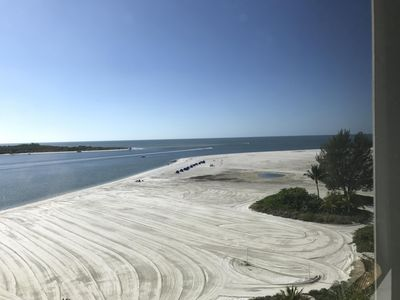 View from 601's Lanai! Groomed white sand and never a crowds or party people.