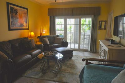 Beautiful condo with leather seating and large screen smart TV