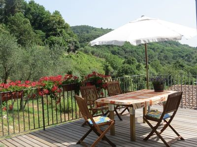 Photo for Detached 'rustico' among the olives, terrace with beautiful views of Lucca