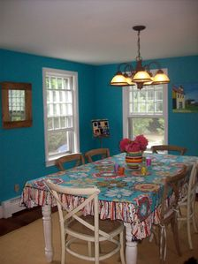 This whimsical dining room is part of the open concept with the kitchen