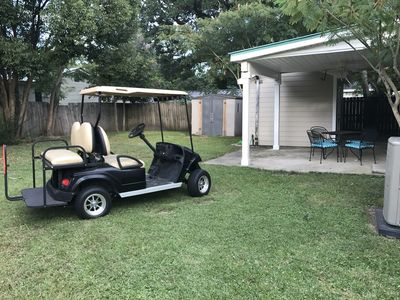 Beach house backyard with golf cart included in rental and covered patio w BBQ