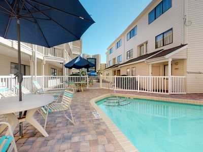 Photo for Ground floor condo w/ shared pool - walk to the beach!
