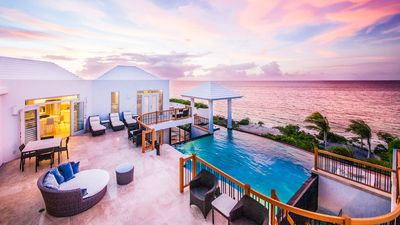 Photo for Beachfront Mothershouse surrounded by reef for world-class snorkeling & heated infinity pool