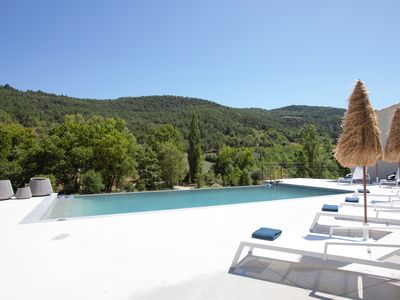 Photo for Old restored workshop, with swimming pool and breathtaking views, 12 km Nyons