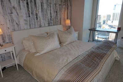 Master Bedroom with King-Sized Bed and view over downtown