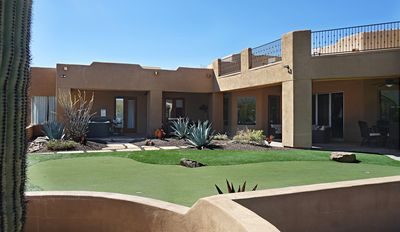 Photo for 5 Bedroom 4.5 Bath Luxury 4700 Square Ft Home with heated pool and hot tub