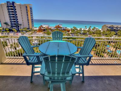 Photo for Classy condo with shared pool, BBQ area & fitness center - gulf and pool views!