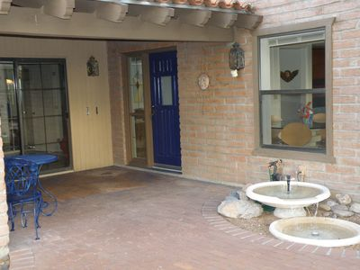 Welcoming front entrance with fountain