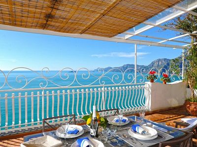 Photo for Villa Lorena: An elegant and welcoming apartment that is part of a villa built sheer above the sea, with Free WI-FI.