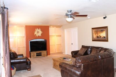 "Family Room with 55"" TV Cable Blu-Ray Player Ceiling Fan Surround Sound"